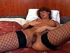 Ripened Courtesan In Fishnets Takes Dark Rod