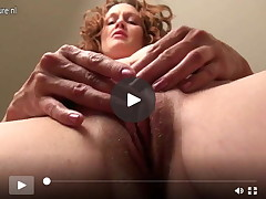Sexually intrigued American mama playing with her smooth head cage of love