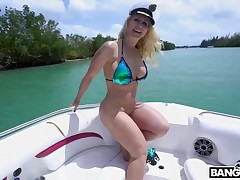 Curvaceous blond woman, Ryan Conner likes to accept a heavy snake up her ass, in a boat
