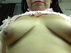 Naughty hoe floozy Vilma is a mellow lady that fond of to screw around. that babe takes off her top and shows off her sagging, natural boobs. Watch as that babe pinches her black nipples. This girl takes off her short skirt and shows her shorts and saggy