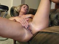 This clammy milf feels kinda lonely. That babe is lying on her sofa and instigates touching her own nipples. That babe takes her brown nylon underclothing off and amplifies her attractive legs in order to rub that soaked cunt of hers. That babe strokes it