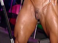 bodybuilder established in training center with high heels