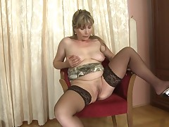 Elvira takes a sit on her chair and prepares herself to show us smth astonishingly nice. She's a gorgeous grown blond that had a lot of hard jocks in her twat and now that babe coverts to spend some quality time alone, with us. So, the blond spreads her g
