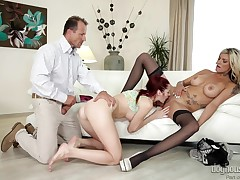 A redhead girl and a breasty milf have fun, sharing the same cock. The concupiscent guy squeezes the fairy-haired bitche's tits, whilst the wench is eating her lusty pussy. Kattie seems to enjoy, when the two adults charmed her to engulf cock, or when the
