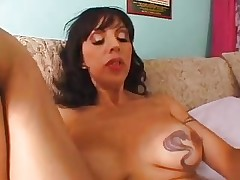 Busty Tattooed MILF Needs Cock In Her