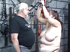 Stout titted bulky fuck and play dark brown receives caned and whipped by master