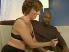 MILF receives a large black cock