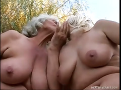 Blond grannies eating damp wet crack outdoors