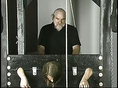 Old man pounds adolescent dark brown with little tits jailed in stocks