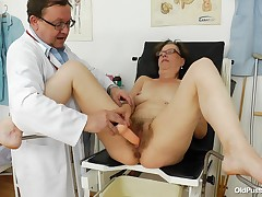 Saggy wench Slaven is at her gynecologist. The doc putted her to take a sit on the odd table and then this chick spread her legs. That guy putted some lube on her hairy vagina and then asked her to spread it with a dildo. Now that her vagina is roomy enou