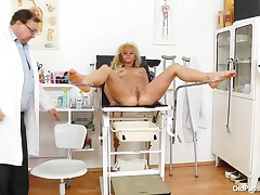 Established bitch Patricie is at her local doc for a check up. This girl lays naked on the table and the doc inserts a thermometer in her backdoor to check her temperature. It seems that she's a bit to hot so he asks her to sit on the gynecologist table t