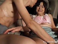 This Japanese lady sits in the previously of her car with her youthful associate and this chick lets him engulf on her nipples. This girl pulls out his jock and keen to how major it is. This girl does a valuable job of jerking him off cuz this chick has y